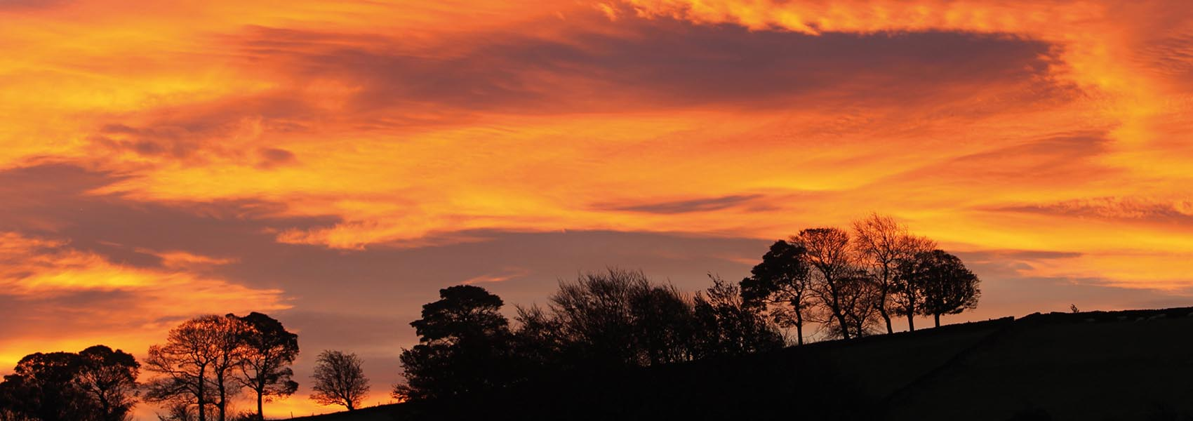 Cloud formations at sunrise over Mill Bank, Ripponden.